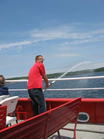 Ride The Fireboat : Our guide demonstrating the firehose. We all got a turn!