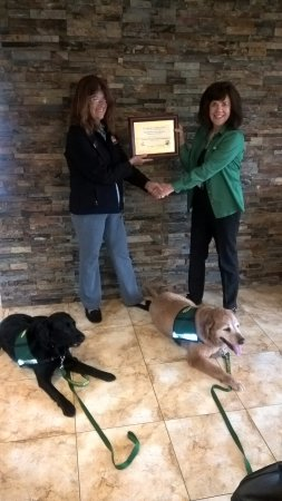 Clarion Inn & Suites Airport: Deb Hunt, manager, receives a Certificate of Appreciation from HOPE AACR