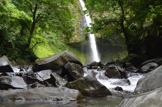 La Fortuna Waterfall from around the rocks at the bottom