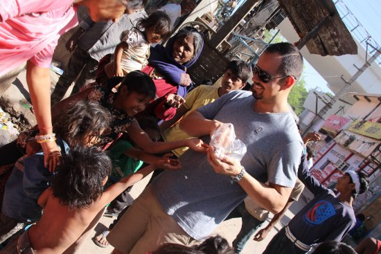 handing out candy to the kids picture of pete for india travel