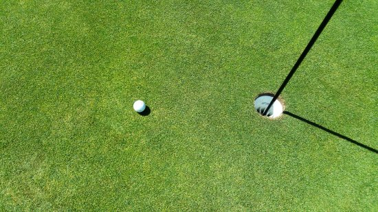 "Ephraim, WI: My ""almost hole in one"" from the 17th par 3 and 156 yards. Put in for birdie."