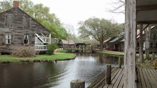 Acadian Village: The little lake with Acadian historical homes and buildings.