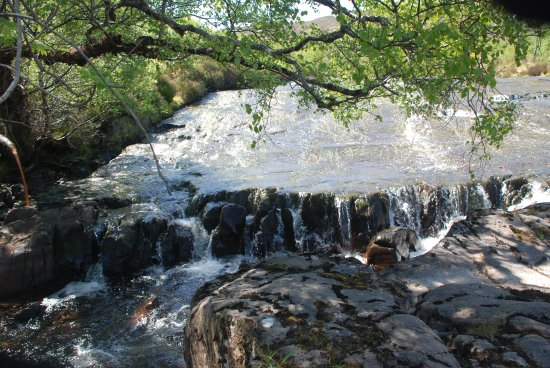 Gairloch, UK: water flowing over rock formation at head of falls .....