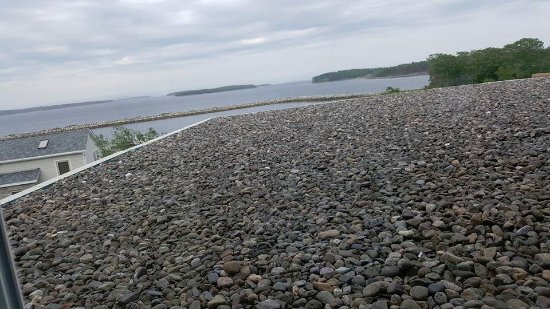 Atlantica Oak Island Resort & Conference Centre : this was our second room, obstructed pebble roof with ocean in background,