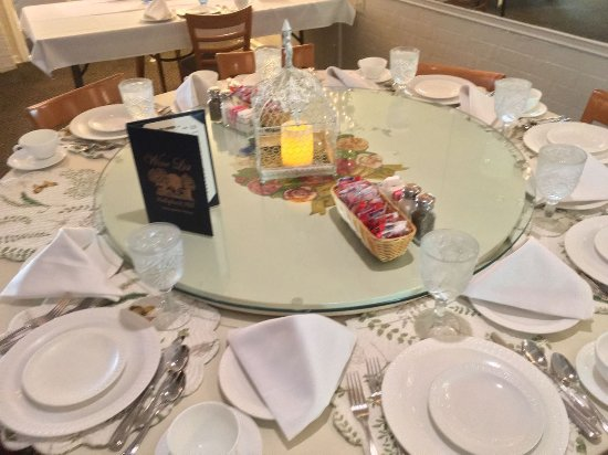 our family dining table setting with large lazy susan - Picture of ...