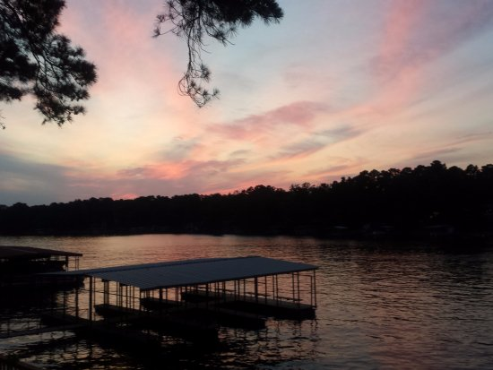 Country Inn Lake Resort: Always beautiful sunsets. One of the private boat docks in the foreground.