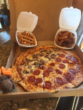 Penn Yan, NY: Our take-out meal. Pizza with a side of French Fries and Onion Rings! They were yummy!