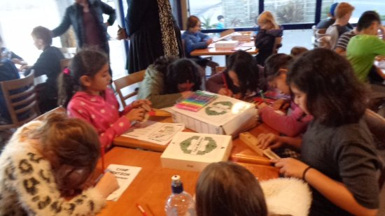 Cafe Sandspit: kids are doing their school booklet while waiting for food to be served