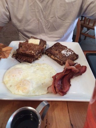 Love Bites Cafe: Eggs over easy and yummy french toast with Bacon, my husband loved it