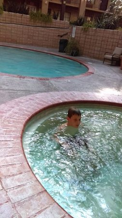 Caleb enjoying pool picture of best western of for Uniform swimming pool spa and hot tub code
