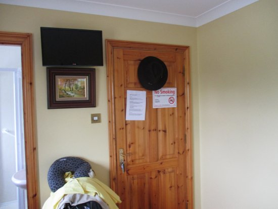 Scarriff, Ireland: TV and entry door to my room at Clareville House