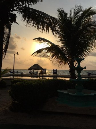 Seine Bight Village, Belize: Sunset at Nautical Inn - view from restaurant patio