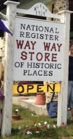 Saco, ME: Store road sign greeting visitors