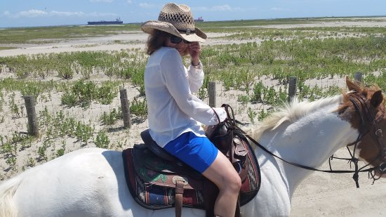 Galveston Island, TX: First time on a horse. But quickly enjoying the experience!