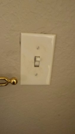 Country Inn & Suites By Carlson, Port Canaveral: This light switch/cover plate was not securely screwed into the wall.