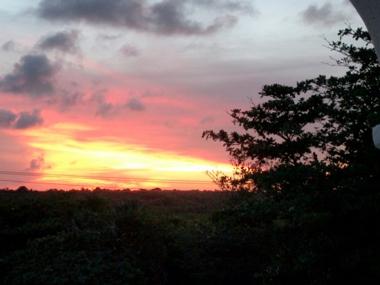 Playa Caribe: View from the balcony facing the road- Beautiful sunset