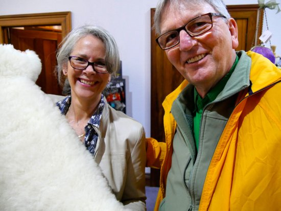 Ross, Australia: I buy a sheepskin and get a pic with the saleslady. The sheepskin is sooooo soft.