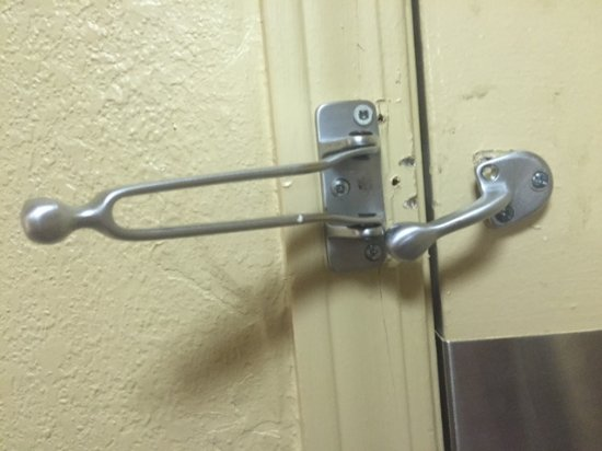 Hazelwood, MO: Security lock hanging off door