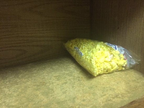 Hazelwood, MO: Inexplicable, half-empty bag of popcorn in the cabinet