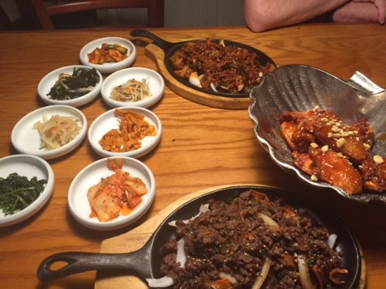 Bulgogi Beef At The Bottom Chicken Wings And A Pork Dish At
