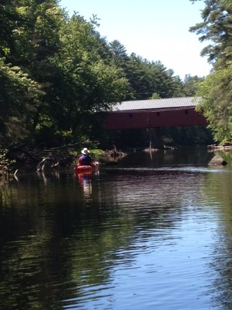 Swanzey, NH: My husband about to kayak under the bridge.