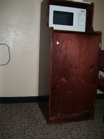 Lebanon, IN: Well worn microwave and refridgerator cabinet, cipped along the bottom