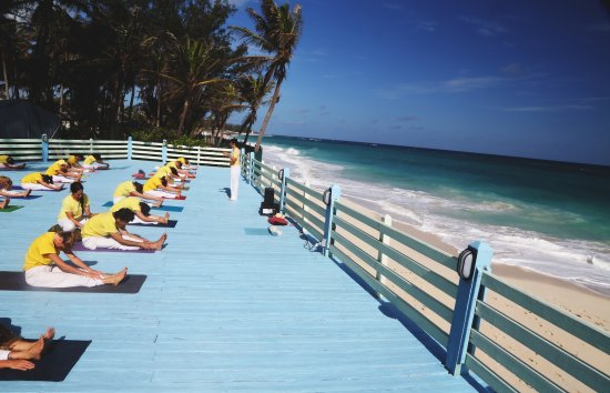 Sivananda Ashram Yoga Retreat: Yoga Class on the Beach Platform