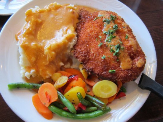Novak's Hungarian Restaurant: Chicken Cordon Bleu served with Paprikas sauce over mashed potatoes and fresh vegetables