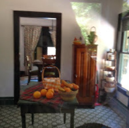 Port Orange, FL: Kitchen of Gamble Place cottage, circa 1920 furnishings, with dining room in background.