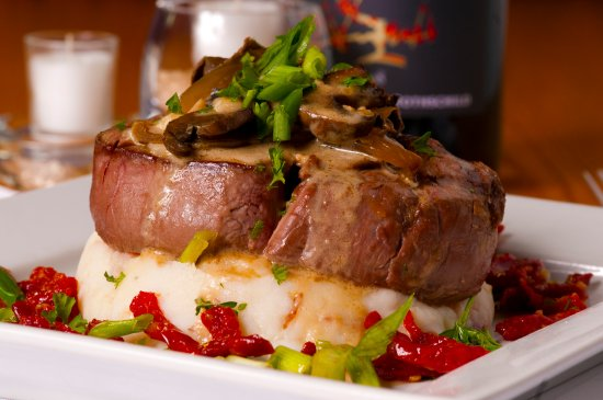 Millhouse Steakhouse Jacksonville: Filet Mignon drizzled with Marsala Sauce and Mushrooms.