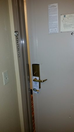 Modesto, CA: Door wouldn't close all the way without force. Please note no fastener for chain. No inside lock