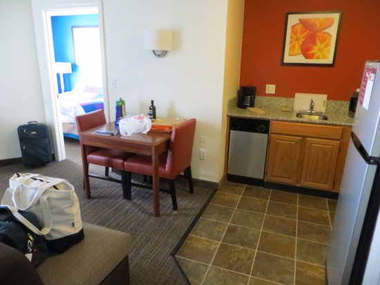 Residence Inn Danbury: Kitchen area, dining table, and view into the bedroom.