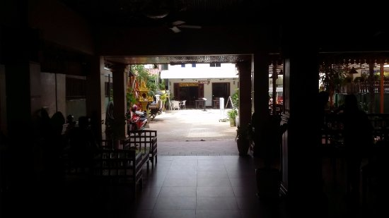 Angkor Voyage Villa: Looking out on a storm filled day, through the restaurant, quite dark but certainly not so gener