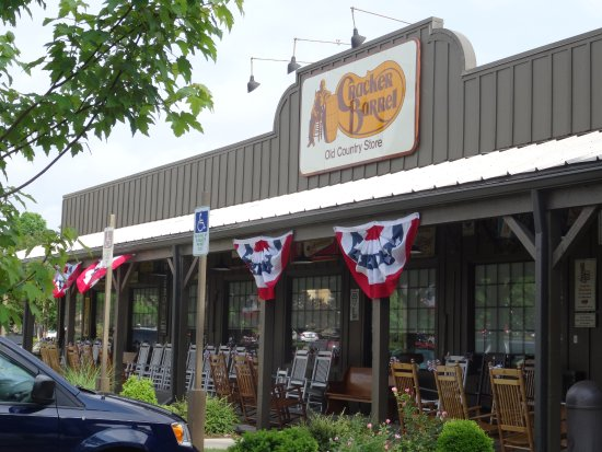 Employee walking away from front parking - Picture of Cracker Barrel