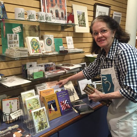 Sacred Heart Cultural Center: Gift store manager Judy Evans working on author book display