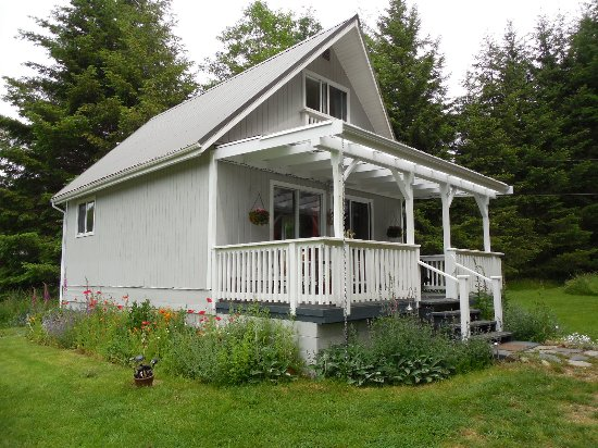 Denman Island, Canada: the cottage with covered deck great for relaxing with a glass of wine!