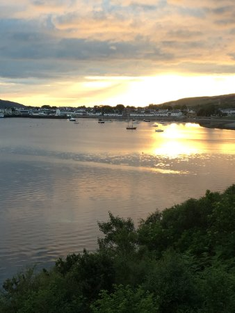 Tanglewood House: View from our balcony of a sunset over Ullapool.