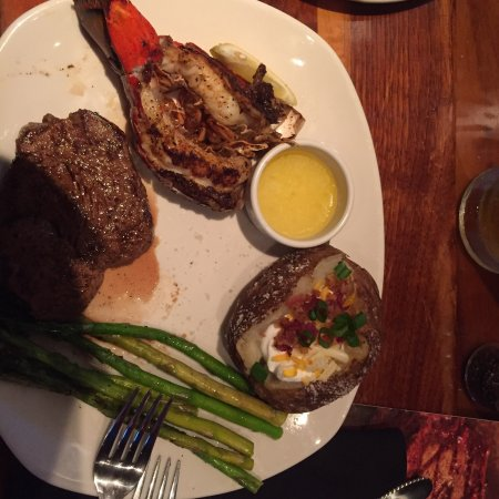 Photo of Steakhouse Outback Steakhouse at 606 Greenville Blvd Sw, Greenville, NC 27834, United States