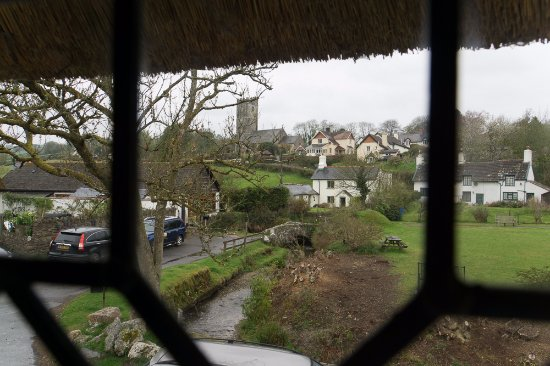 Winsford, UK: View showing the thatched roof and the village green.