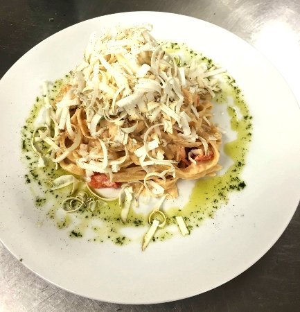 Homemade Fresh Pasta with tomatoes and smoked ricotta