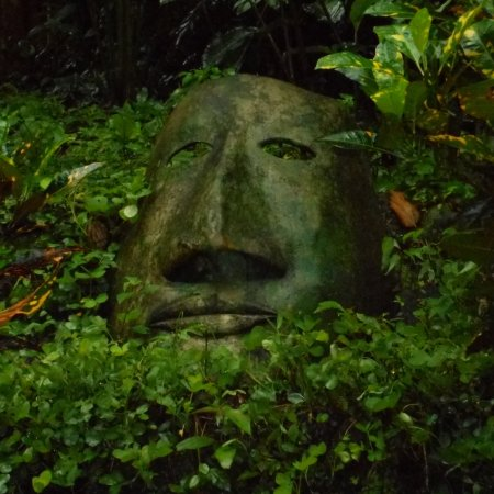 """Tak'alik Maya Lodge : This huge metal mask is just outside """"our"""" room, and was our guardian angel."""