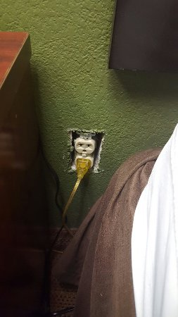 West Valley City, UT : Oh look another outlet with no cover, and this one is next to the bed! This is absolutely unacce