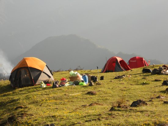 Lanping County, China: Camp site and tent, trekking Biluo snow mountain.