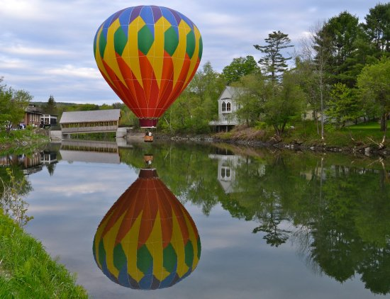 Enjoy a magical flight with Quechee Balloon Rides - Floating over the Ottauquechee River