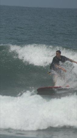 Tortuga Surf School: Coaching on helping me drop in backside