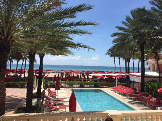 Sunny Isles Beach, FL: One of three pools, view of ocean and cabanas