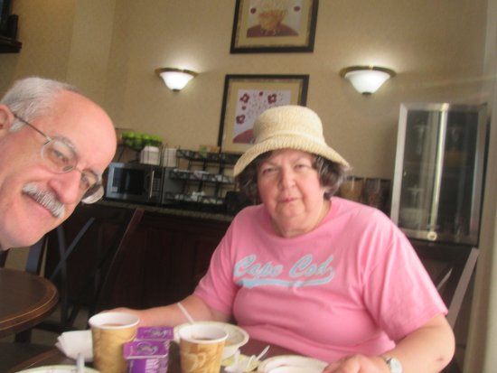 America's Best Inns & Suites: Louis and I having a continental breakfast.