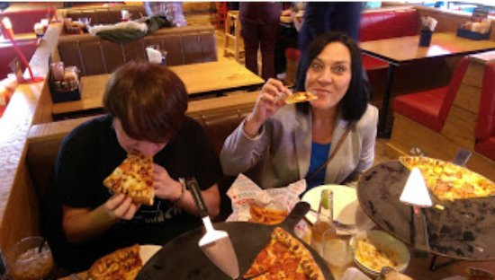 The Wife Young One Tucking In Picture Of Pizza Hut