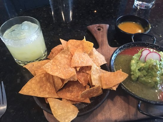 Happy hour chips, salsa, and guac & barrio margaritas