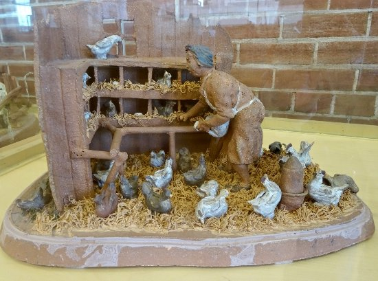 "Kapuskasing, Canada : Clay Figurine, ""Feeding the Chickens,"" by Maurice Gaudreault"